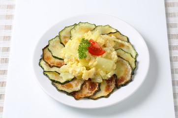Roasted zucchini with potato egg scramble