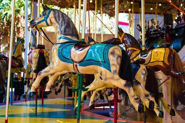 Wooden horses on merry-go-round carousel