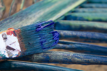 brushes after painting with rainbow background