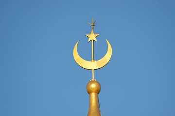 Moon and star of a Mosque with blue sky