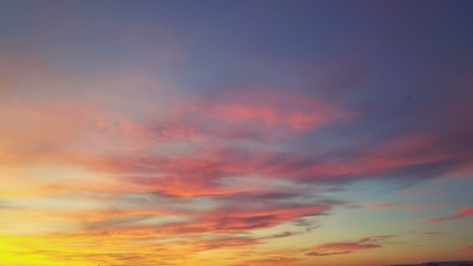 Colorful sunset, sky with clouds as a background