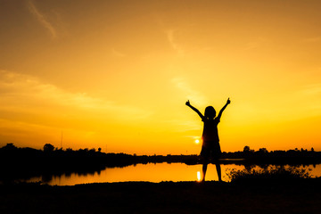 The Winner girl stand alone with sunset background