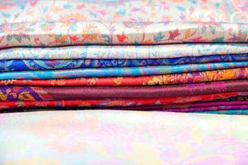 Traditional colored fabrics in the Indian market. Tippets.