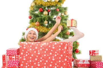 Beautiful  smiling woman and the Christmas tree.