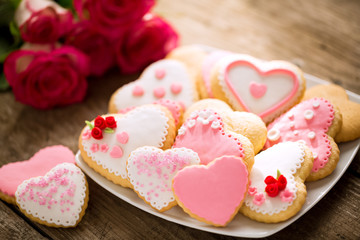 Plate of rose and red valentines cookies