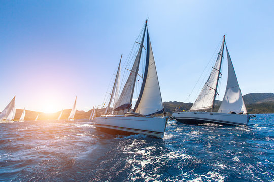 Luxury yachts at Sailing regatta. Sailing in the wind through the waves at the Sea.