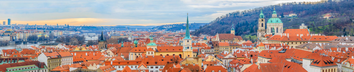 Wall Murals Prague Panoramic view onto red roofs of Prague and river Vltava