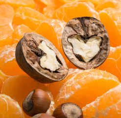 nuts heart of juicy orange slices