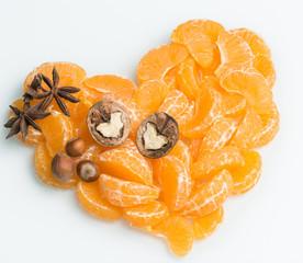 orange heart of juicy orange slices with nuts