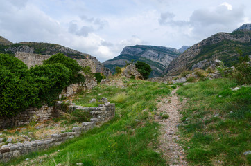Ruins of fortress walls with views of mountains, Old Bar, Montenegro