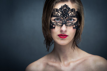 Attractive young woman with mask (color toned image)