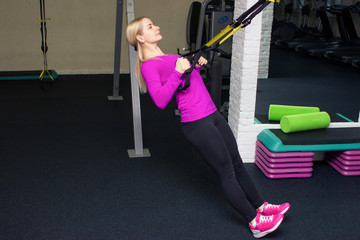Fitness beautiful girl trainer do some exersice with fitness  equipment