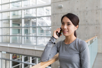 Woman make a call by mobile phone