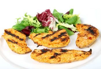 Summer barbeque chicken with green lettuce salad