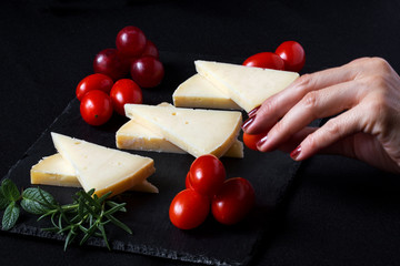 Manchego cheese with grapes, mint and rosemary