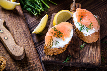Healthy salmon with cottage cheese on serving board