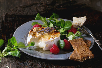 Baked Goat cheese with honey and raspberries