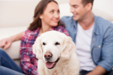 Attractive husband and wife with cute pet