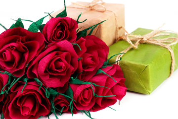 Paper red roses and gifts boxes
