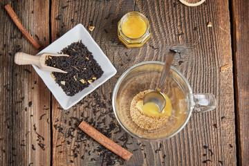 Brown sugar and honey in a tea glass and cinnamon and orange sli