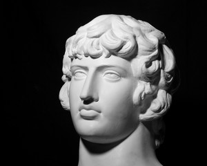 White gypseous head of a young man