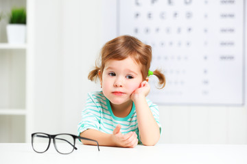 concept vision testing. child  girl with eyeglasses