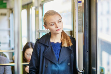 Young woman travelling in a train of Parisian underground