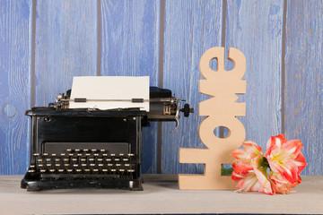 Antique typewriter with flower