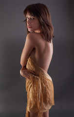 Pretty Woman Covering Self With Gold Fabric