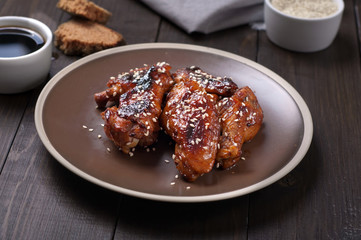 Chicken wings in and sauce with sesame seeds