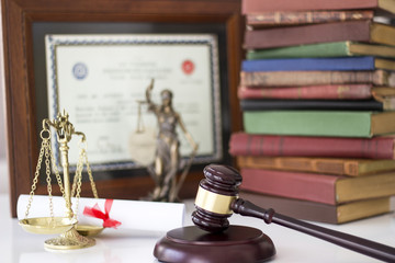 Law concept, statue, gavel, scale, books and diploma