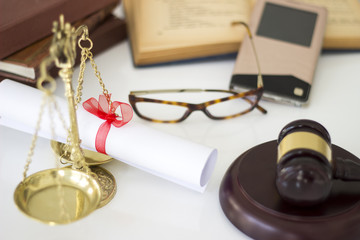 Law concept, gavel, scale, boks, mobile phone and diploma