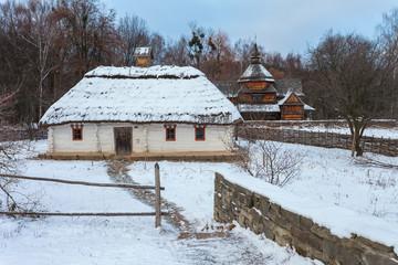 Traditional Ukrainian village in winter. Old house at Pirogovo ethnographic museum, Ukraine