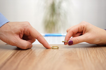 husband and wife are returning wedding rings,divorce concept