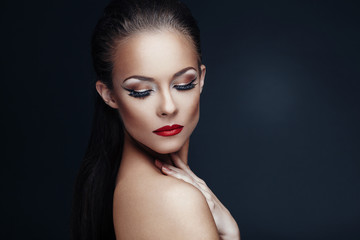 Portrait of beautiful woman with nice makeup on dark background