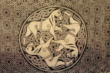 Celtic ornament of three horses on the fabric. Ancient symbol of
