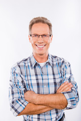 Confident happy aged man in glasses crossing hands