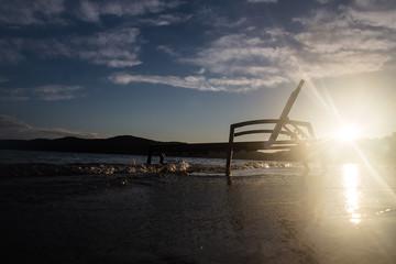 Chaise lounge at seashore