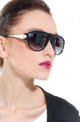 Close-up portrait of beautiful girl in sunglasses