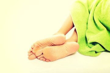 Close up on female legs wrapped in towel