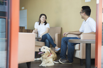 asian couple at cafe with their pets