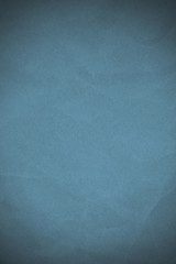 Abstract old and crumpled paper that is dyed blue for Background