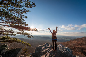 Happy female hiker at the summit of an Appalachian mountain