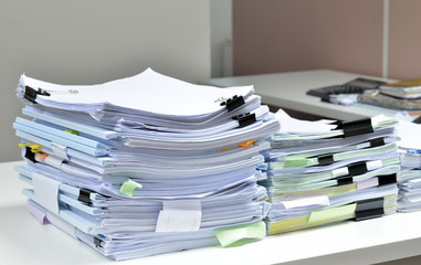 Pile of documents on desk at workplace