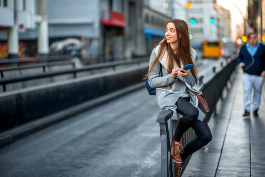 Woman with phone in the city