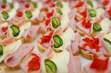 Beautifully decorated,  food snacks and appetizers with sandwich,  on party  or wedding celebration