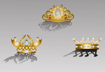 three crowns on grey background
