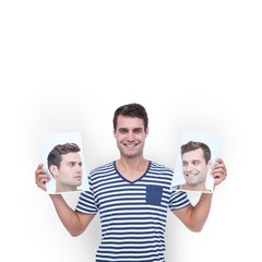 Man holding photos of his face
