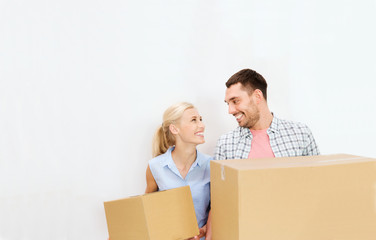 couple with delivery boxes moving to new home