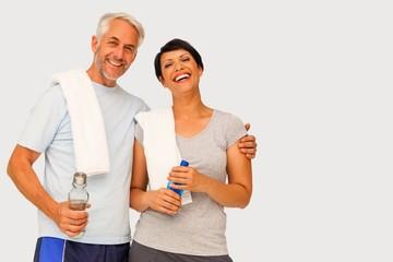 Composite image of portrait of a happy fit couple
